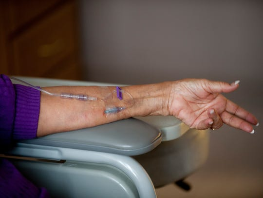 Detail of the arm of Augusta Thomas, 83, as she undergoes