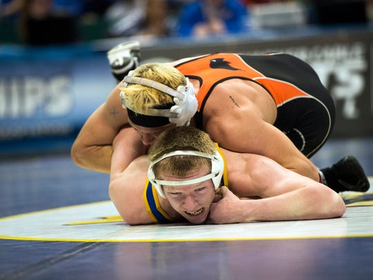 In the state championship bout, Kobe Garrehy, bottom, fell behind 2-0 on a takedown, but quickly earned a reversal and won, 8-3