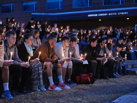 A vigil is held for Willem Golden at Skidmore College in Saratoga Springs, New York, on Tuesday. Golden, who would have graduated in 2019, died Saturday in Newark.