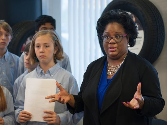 Representative Chandra Dillard stands with Charles Townes Center students to explain a bill that would ban lead wheel weights in South Carolina at The Tire Exchange on Monday, April 11, 2016.