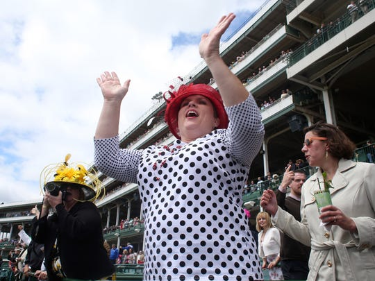 Laura Newton cheers during the first race on Thurby at Churchill Downs.