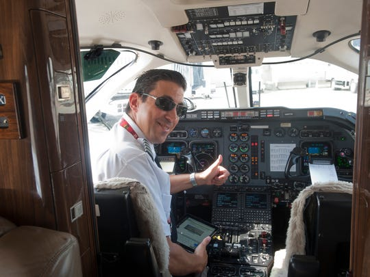 John Graff, OneJet Captain and Check Airman gives a thumbs up after flying the new regional airline company plane on its maiden voyage arriving at Louisville International Airport from Pittsburg.  25 July, 2016