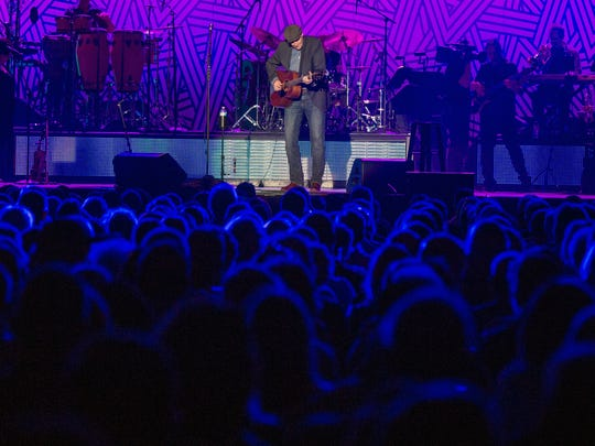James Taylor performs at the Floyd L Maines Veterans