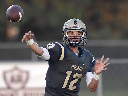 Pearl quarterback Jake Smithhart (12) throws against