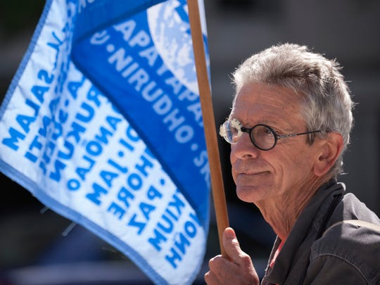 Charlie Nash participates in a peace protest in front of the Capitol on Friday, Sept. 2, 2016. A handful of Lansing residents have been in front of the Capitol every Friday since the Friday after Sept. 11, 2001 to protest in favor of peace.