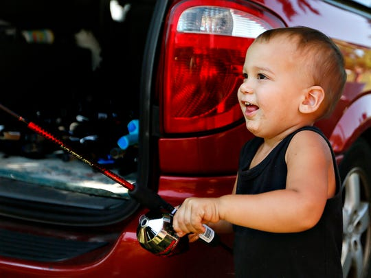 Eli Sackett, 2, of Dover, reacts after being awarded