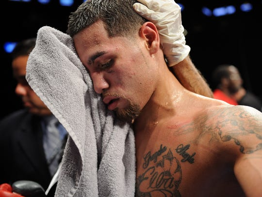 Michael Perez towels off following the fight against Miguel Zuniga at Barclays Center's Cushman & Wakefield Theater on September 30, 2013 in the Brooklyn borough of New York City. (Photo by Maddie Meyer/Getty Images)
