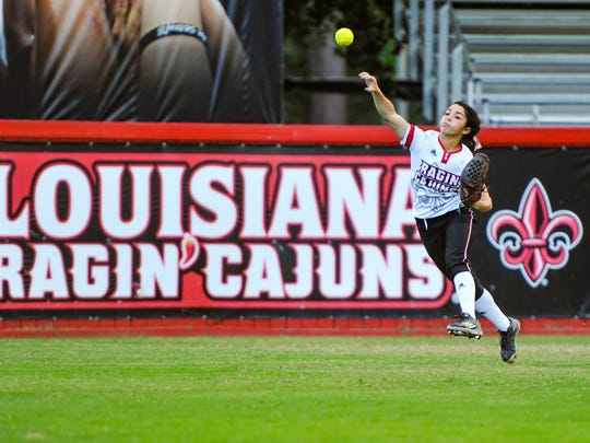 UL outfielder Kelli Martinez makes a throw from the outfield during the Cajuns' fall ball game against the USSSA Pride.
