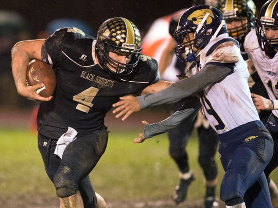 Windsor quarterback Cory Hagerman stiff arms Susquehanna Valley defensive back Joseph Hoskins during the third quarter of Windsor's 27-14 win on Friday.