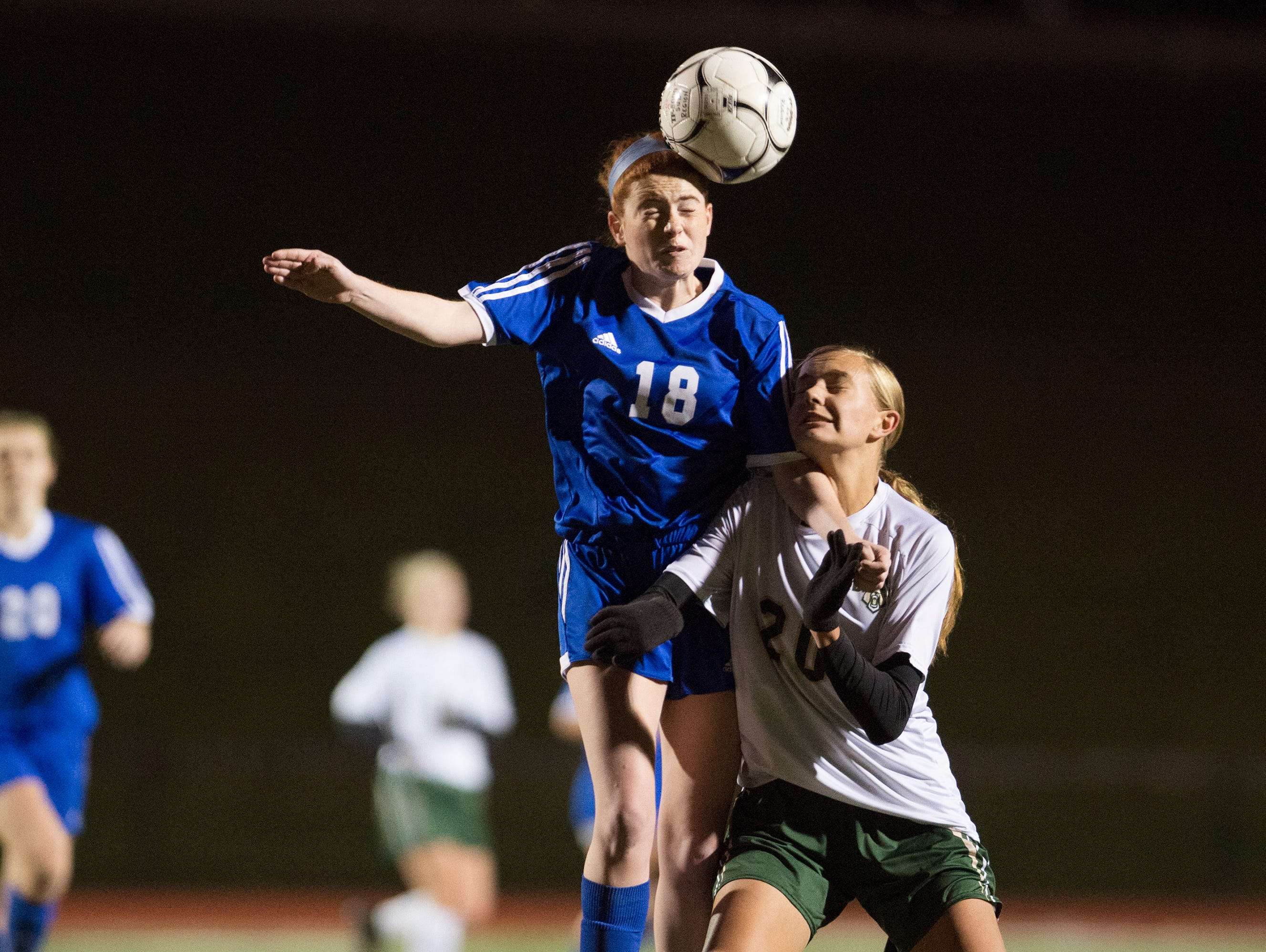 Pearl River's Shaelynn Guilfoyle (18) heads the ball past with Vestal's Kellie Kostek during the first half of Pearl River's 1-0 win in the Class A sub-regional of the high school soccer state playoffs on Tuesday, Nov. 1, 2016.