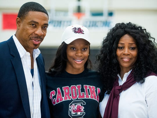 Brew Tech's Bianca Jackson poses with her parents Lewis and Freda Jackson after Bianca signs to play basketball with South Carolina at the Brew Tech campus in Montgomery, Ala. on Wednesday November 9, 2016.