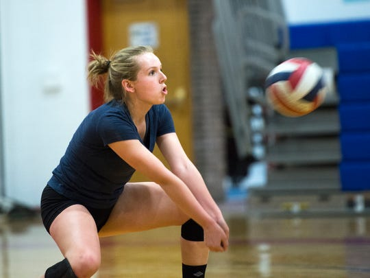 Owego junior McKenzie Hart returns the ball during Tuesday's practice. Hart stepped into the libero role for the Indians this season.