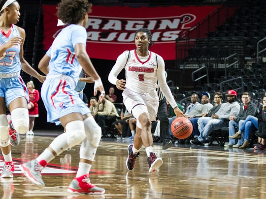 Jasmine Thomas moves the ball down court as the Cajuns take on LA Tech at the Cajundome in Lafayette, La., Thursday, Dec. 22, 2016.