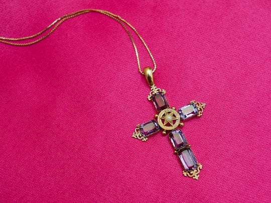 When Sally Erny's grandmother, Martina Rockhill Wilson, was age 12, Wilson's mother took her to Italy as a birthday gift, and Wilson brought back this amethyst and pearl cross.