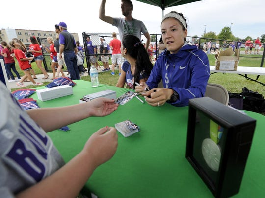 Olympic silver medalist Chloe Dygert signs autographs before a Brownsburg football game Aug. 26.