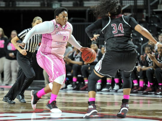 Nekia Jones drives to the basket as the Cajuns take on Troy in women basketball Saturday, Feb. 11, 2017.
