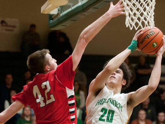 With the score tied in overtime, Floyd Central guard-forward