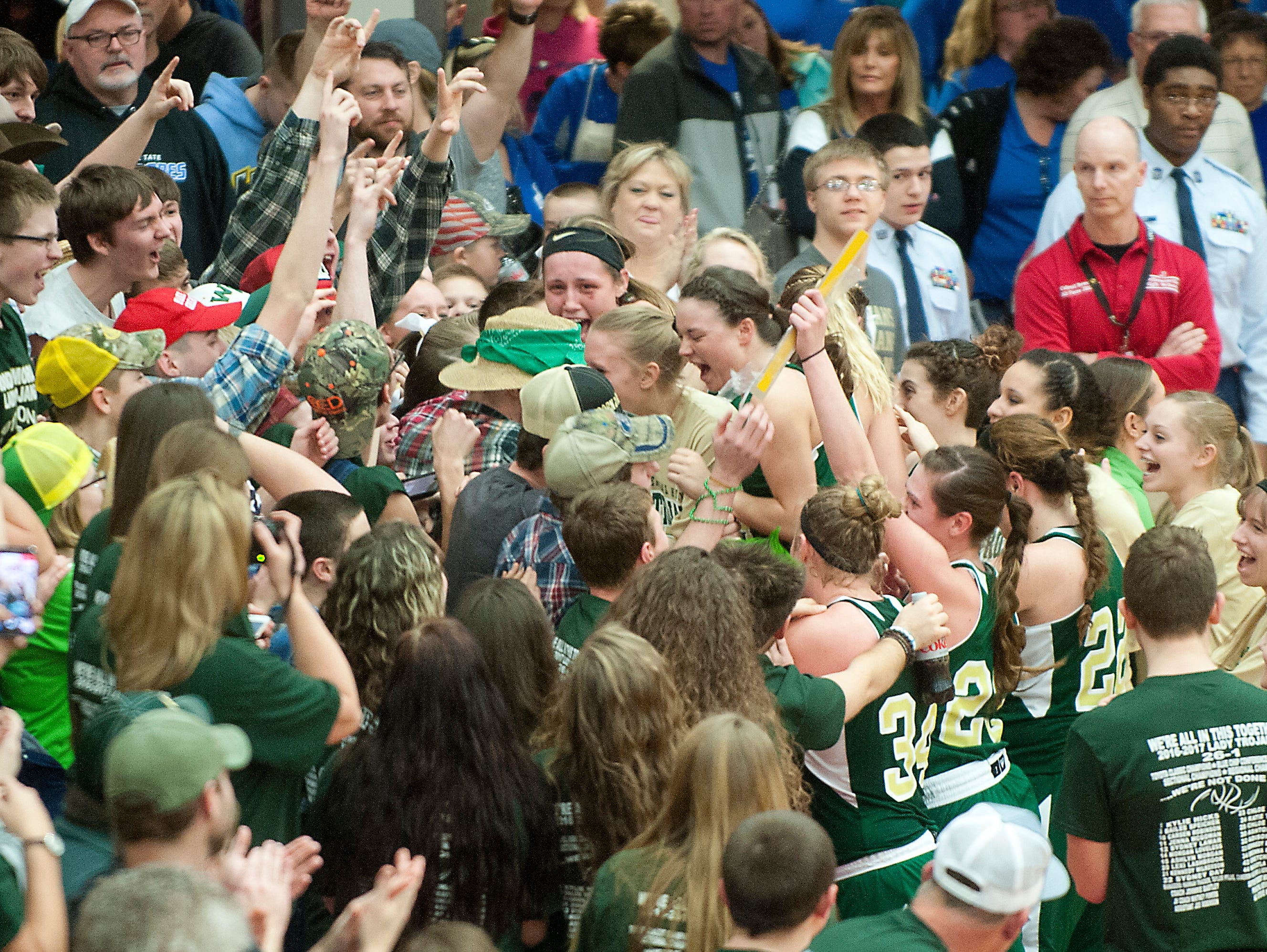 Wood Memorial players are mobbed by their fans after beating Tindley 59-50 in the IHSAA girls' class 1A semi-state. 17 February 2017