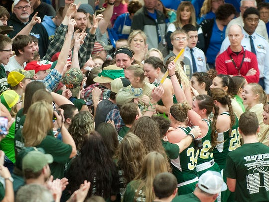 Wood Memorial players are mobbed by their fans after beating Tindley 59-50 in the IHSAA girls' class 1A semi-state.17 February 2017