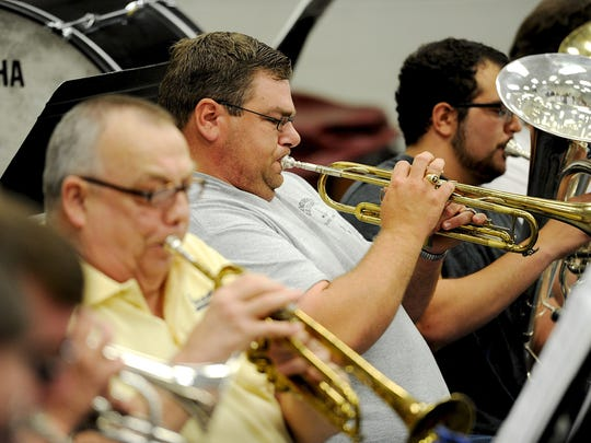 Jonathan Self rehearses with the Community Band at