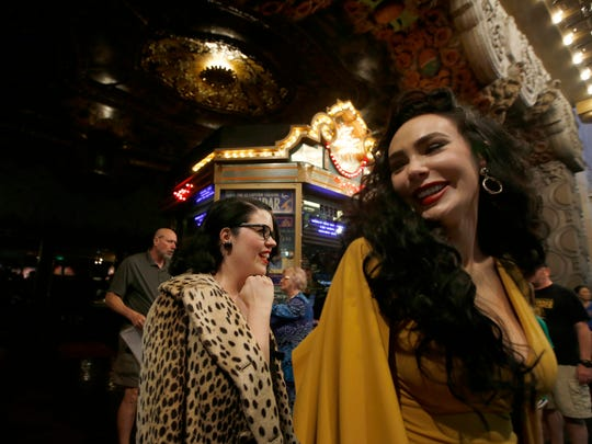 Melissa Firestone, left, and Micheline Pitt, right, are all smiles as they exit the Beauty and the Beast Los Angeles premiere at the El Capitan Theatre March 16, 2017 in Hollywood, Calif.