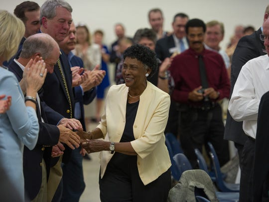 Ella Thomas shakes hands with those in the crowd after being announced as Kyndle's  Distinguished Citizen of the Year.