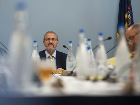 University of Michigan President Mark Schlissel speaks during the Board of Regents meeting on Thursday, June 15, 2017 at the Michigan Union in Ann Arbor. The new Go Blue Guarantee, unveiled and approved by the board will offer free tuition to some in-state students. Rachel Woolf, Special to the Free Press