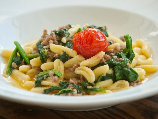 Cavatelli con broccoli di rabe e salsiccia, or homemade pasta with ricotta cheese, broccoli rabe and Italian sausage, is one of the featured dishes at ROC, a new Italian restaurant on Bardstown Road.