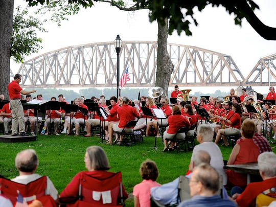 The Community Band performs for a packed Audubon Mill Park at a past year's Independence Day celebration.