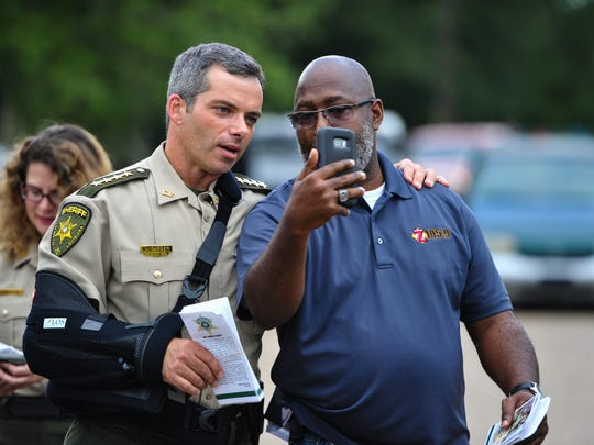 Sheriff Mark Garber and Sheriffs Deputies walking neighborhoods in Acadiana meeting and talking with residents.  Monday, June 12, 2017. (Pictured- Sheriff Mark Garber and Joe Dupree-Anderson)