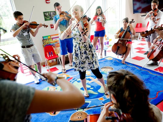 Hanneke Cassel, of Boston, Mass., (center) teaches students an Irish Reel during the first day of the Mike Block String Camp at the First Presbyterian Church in Vero Beach in 2014. They later performed at the Vero Beach International Music Festival. This year's festival includes free performances through July 14.