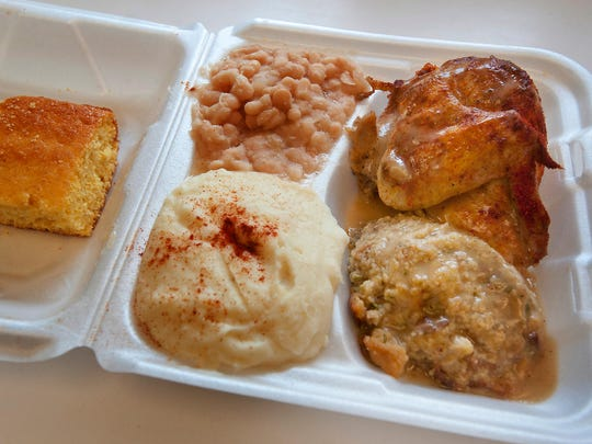 Big Mama's Soul Food's chicken dinner with beans, mashed potatoes and stuffing. The restaurant on W. Broadway, a block from Shawnee Park.