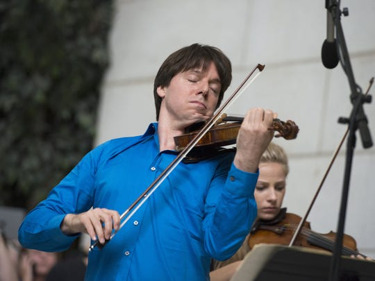 Acclaimed violinist Joshua Bell performs with young musicians who are alumni of the National YoungArts Foundation (YoungArts) in 2014, at Union Station in Washington. Bell will perform with the Indianapolis Symphony.