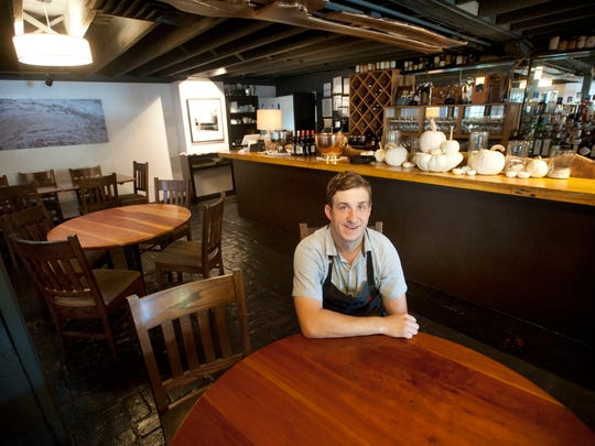 Chef Kevin Ashworth of 610 Magnolia sits next to the bar in the restaurant dining room. Oct. 3, 2017