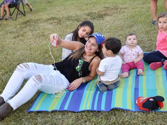 Johana Pardon enjoys the music and snaps a selfie with