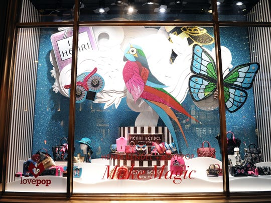 Henri Bendel Holiday Window feature intricate papercut sculpture by LovePop. (Photo by Craig Barritt/Getty Images for Henri Bendel)