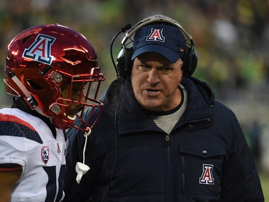 Rich Rodriguez has some words with safety Scottie Young