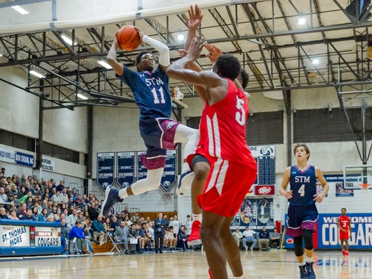 Cougars Jonathan Cisse drives to the basket as STM faces off against Riverside in the finals of the Sunkist Shootout. Saturday, Dec. 30, 2017.