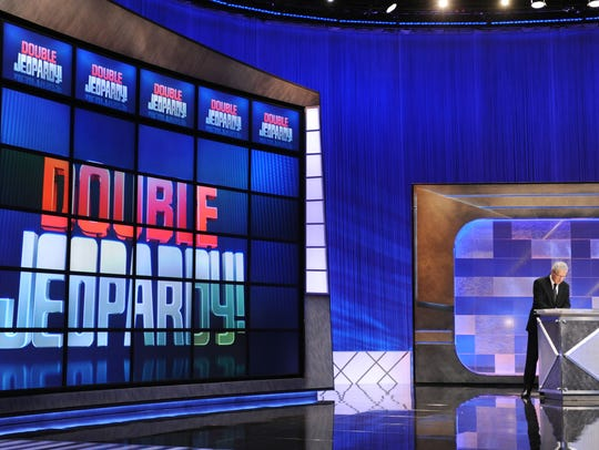 Game show host Alex Trebek rehearses his lines on the