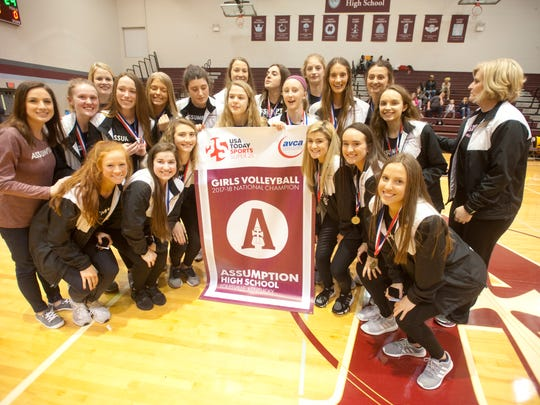 """The Assumption Rockets pose with their USA Today Sports Super 25 Girls Volleyball 2017-18 National Champion banner. The Rockets made it to the top of the USA TODAY high school """"top 25"""" sports rankings after playing a grueling schedule, losing only 3 games and again capturing the state high school volleyball championship. Helping hold the banner, in the center are team members Claire Hellmann, center left, and Savannah Neal, center right.Feb. 14, 2018"""