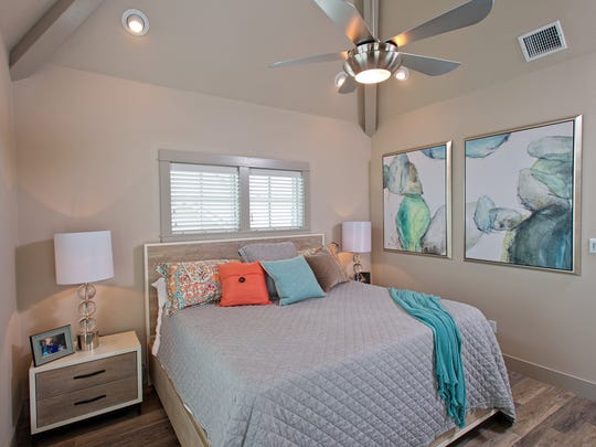 The 3rd master suite features a vaulted beamed ceiling,