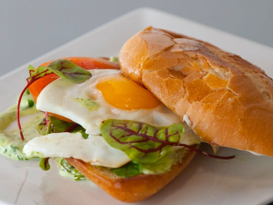 Chef Paco Garcia's torta is made with a crusty Mexican bollilo (a Mexican bread) topped with a cilantro-jalapeno aioli, tomato slice, arugula leaves, fried egg and Oaxaca cheese. Feb. 19, 2018