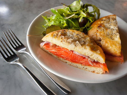 Butchertown Grocery head chef Bobby Benjamin's cold-smoked salmon bialy is made with cold-smoked salmon, chive cream cheese and red onions served on a home-made poppy-seed bialy roll and served with Clarksville's Greatfull Greeens' spicy mix. A bialy is a cross between a roll and a bagel.Mar. 02, 2018