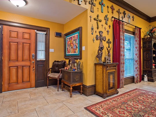 Enter through the Mardi Pena custom painted front door