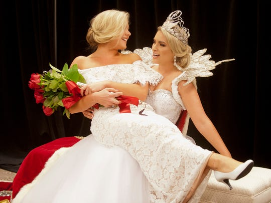 2016 Kentucky Derby Queen Madison Kristine Orman, of Prospect, left, lays across the lap of outgoing Kentucky Derby Queen Natalie Brown, of Crestwood, as the two joke and pose for fun pictures at at the 60th annual Derby Fillies Ball at Galt House East. The good friends are both students at the University of Louisville. April 14, 2018