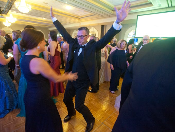 Adam Hitch, of Lake Forest, dances with his wife, Natalie,