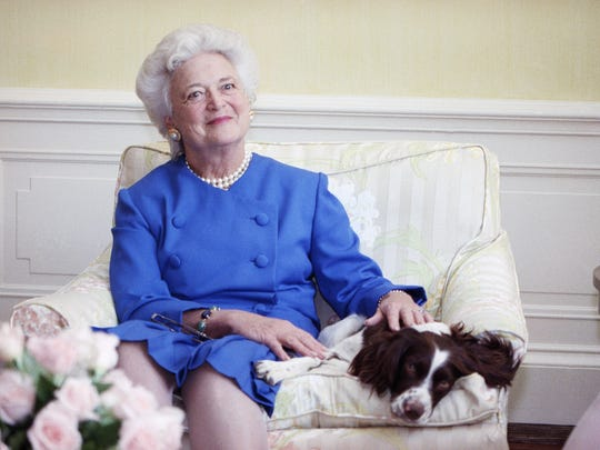 First lady Barbara Bush poses in 1990 with her dog