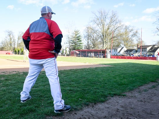 Bosse High School baseball head coach Craig Shoobridge watches action on the field as the Bosse High Bulldogs play the Castle High Knights at Bosse's Washington Avenue field Thursday, April 19, 2018.