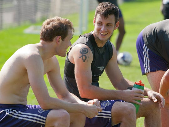 LouCity player Paolo DelPiccolo (center) chats with