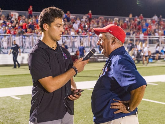 Notre Dame coach Lewis Cook, shown here being interviewed at halftime of a Pioneers' win earlier this season, especially likes the LHSAA's recent shift to higher seeds hosting state semifinal games.